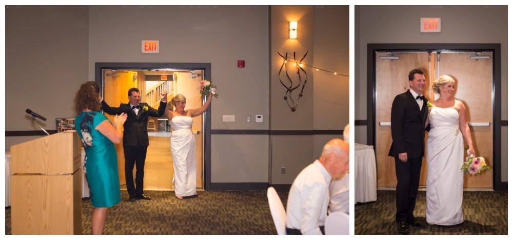 Newlyweds enter wedding reception at the beach club