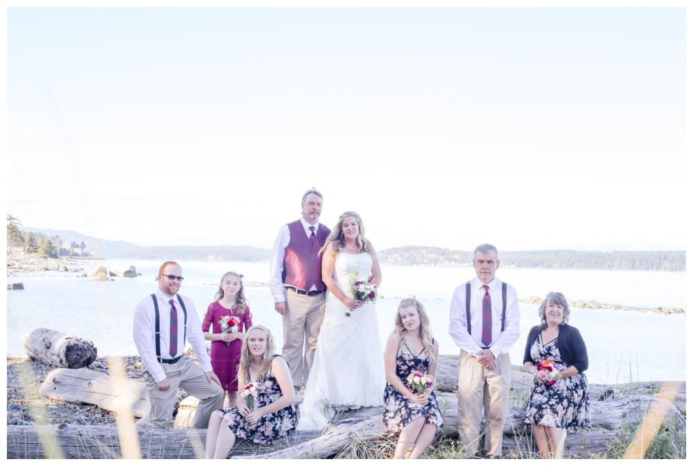 Wedding party photos on Kin Beach in Comox