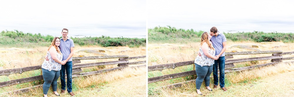 Couple standing by a fence during their vancouver island engagement session