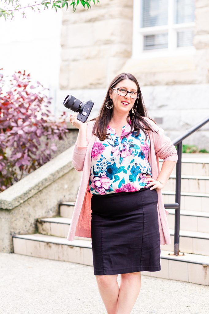 Vancouver Island Wedding Photographer Meaghan Harvey poses with her camera